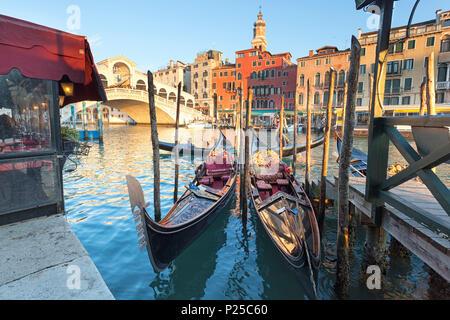 Two traditional venetian gondolas in front of Rialto Bridge, Canal Grande, Venice, Veneto, Italy - Stock Photo
