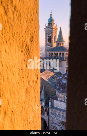 Basilica of Santa Maria Maggiore from a breach in the Civic Tower during sunset. Bergamo(Upper town), Lombardy, Italy. - Stock Photo