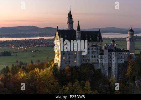 Neuschwanstein castle at dusk. Schwangau, Schwaben, Bavaria, Germany. - Stock Photo