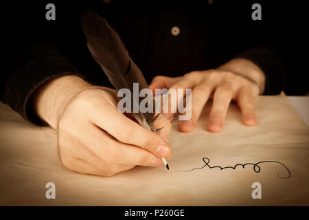 a man's hand holds the fountain pen and the signing of a contract closeup - Stock Photo