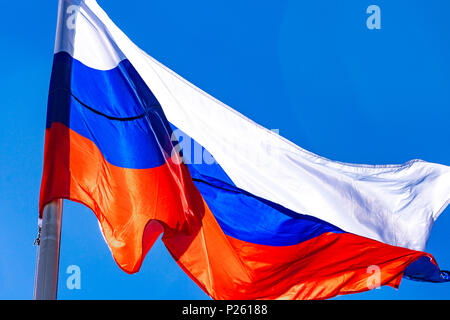 Russian flag against blue sky - Stock Photo