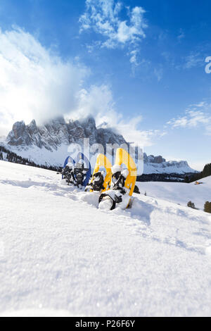 a view of snowshoes in Villnössertal with the Geisler in the background, Bolzano province, South Tyrol, Trentino Alto Adige, Italy - Stock Photo