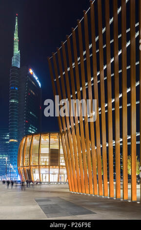 View of the Unicredit Tower, Unicredit Pavillion and the Edificio e3east (called Termosifone) from Alvar Aalto square during the evening. Milan, Lombardy, Italy. - Stock Photo