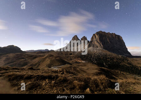 Starry sky on rocky peaks of Sassolungo, Sella Pass, Dolomites, South Tyrol, Bolzano province, Italy - Stock Photo