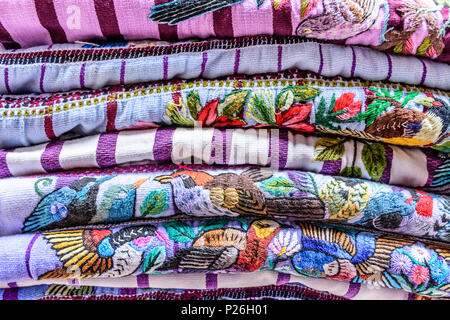 Antigua,, Guatemala -  May 29, 2018: Hand embroidered blouses called huipil made & worn daily by local indigenous Maya women - Stock Photo