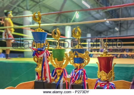 trophies of thai boxing in the ring - Stock Photo