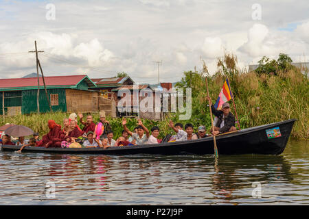 Thaung Thut, house on stilts, canal, boat, monks, Inle Lake, Shan State, Myanmar (Burma) - Stock Photo