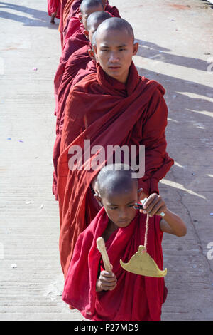 Kyaikto, monks collecting alms at mount Kyaiktiyo Pagoda (Golden Rock), Mon State, Myanmar (Burma) - Stock Photo