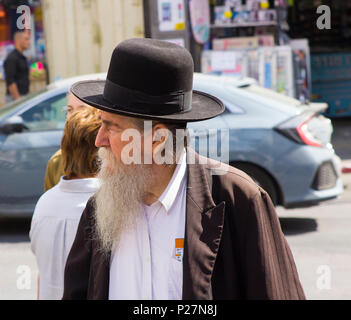 9 May 2018 A aged Hasidic Jew with a long white beard in traditional clothing on foot in a busy street in Jerusalem Israel - Stock Photo