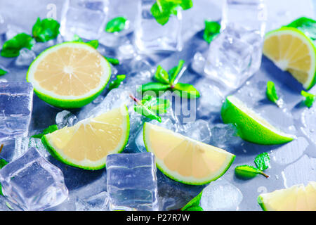 Mint, lime and ice cubes, mojito cocktail ingredients header with copy space. Making summer drinks close-up. Sunlight and refreshment concept. - Stock Photo