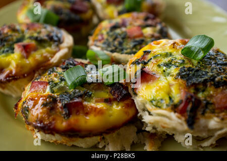 Mini healthy egg breakfast quiches with ham and spinach - Stock Photo