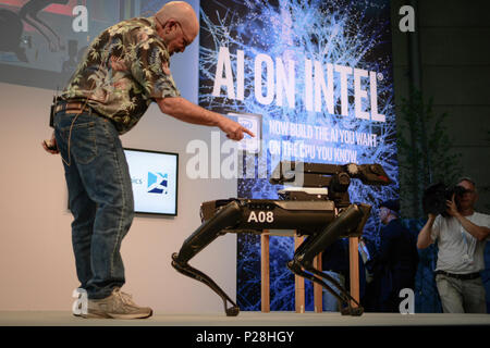 Hanover, Germany. 13th June, 2018. Marc Reibert, founder of Boston Dynamics, presented the SpotMini robot at CeBIT 2018 in Hanover. SpotMini is a small four-legged robot with the ability to pick up and handle objects using its 5 degree-of-freedom arm and perception sensors. Credit: Laura Chiesa/Pacific Press/Alamy Live News - Stock Photo