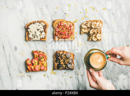 Healthy breakfast with wholegrain toasts , woman's hands with espresso - Stock Photo