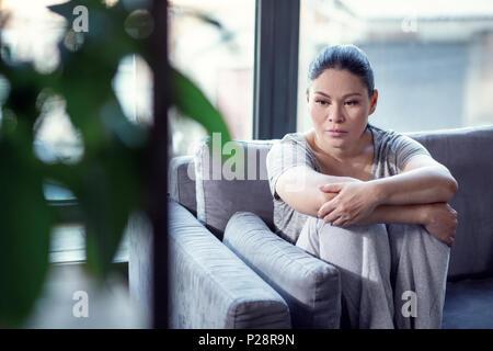 Doomed lamentable woman treating depression - Stock Photo
