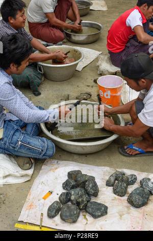 Mandalay, Jade Market, men cleaning stones, Mandalay Region, Myanmar (Burma) - Stock Photo