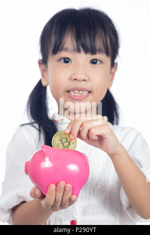 Asian Chinese little girl holding golden Bitcoin in isolated white background - Stock Photo