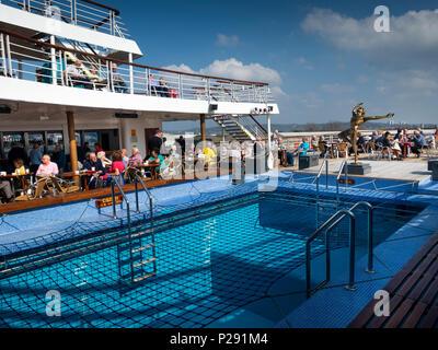 UK, England, Bristol, Avonmouth Docks, MV Marco Polo, cruise passengers enjoying sunshine on aft deck whilst in port - Stock Photo