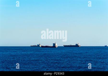 Cargo ships in the open sea. Barcelona, Spain