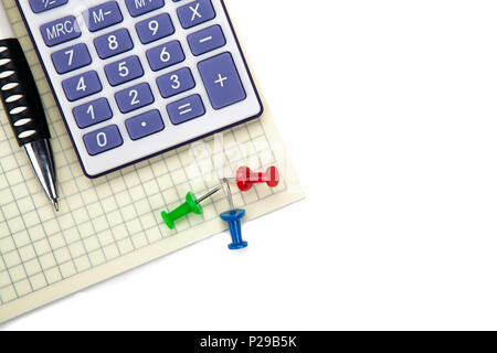 One big calculator and stationery on a white table closeup - Stock Photo