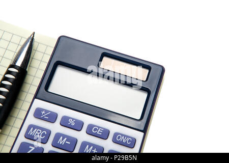 One big calculator and a pen on a white table closeup - Stock Photo