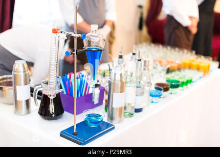 Blue Curacao in a chemical test tube. Set of test tubes and various chemical devices for preparations of molecular cocktails. - Stock Photo