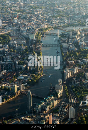 Early morning aerial view of the River Thames through central London from the west. - Stock Photo