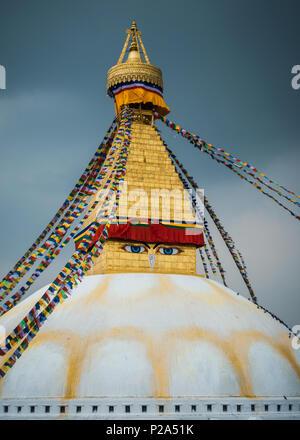 Boudhanath stupa in Kathmandu, Nepal. Stormy clouds in the background. - Stock Photo