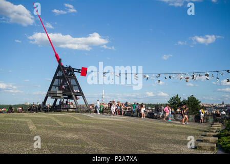 Prague. Czech Republic. People gather at the Metronome in Letná Park for views across the city. - Stock Photo