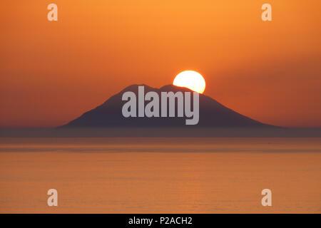 Sunset over the Stromboli, Volcano Stromboli in the evening time - Stock Photo
