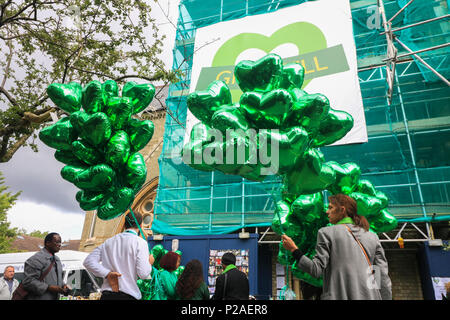 London UK. 14th June 2018. Green ballons to mark the Grenfell anniversary a year after the fire  in West London which claimed the lives of 72 residents in the tower block.  A minute's silence will be observed nationally at midday to remember the victims of the Grenfell fire on 14 June 2017. Credit: amer ghazzal/Alamy Live News - Stock Photo