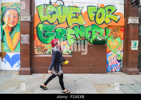London UK. 14th June 2018.  One Year anniversary after the fire  in West London which claimed the lives of 72 residents in the tower block.  A minute's silence will be observed nationally at midday to remember the victims of the Grenfell fire on 14 June 2017. Credit: amer ghazzal/Alamy Live News - Stock Photo