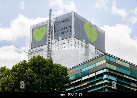 London, UK. 14th June, 2018. Green Grenfell hearts are now positioned at the top of the Grenfell Tower on all sides. Credit: Mark Kerrison/Alamy Live News - Stock Photo