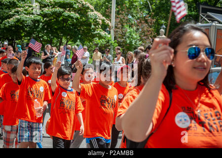 New York, USA. 14th Jun, 2018. Students from PS 140 march in the annual Flag Day Parade in New York on Thursday, June 14, 2018, starting at New York City Hall Park.  Flag Day was created by proclamation by President Woodrow Wilson on June 14, 1916 as a holiday honoring America's flag but it was not until 1949 when it became National Flag Day.  The holiday honors the 1777 Flag Resolution where the stars and stripes were officially adopted as the flag of the United States. (© Richard B. Levine) Credit: Richard Levine/Alamy Live News - Stock Photo