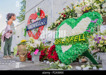 London, UK. 14th Jun, 2018. Messages and tributes, by young and old, are left on railings and walls all around the bottom of the Tower - The first anniversary of the Grenfell Tower Disaster Credit: Guy Bell/Alamy Live News - Stock Photo