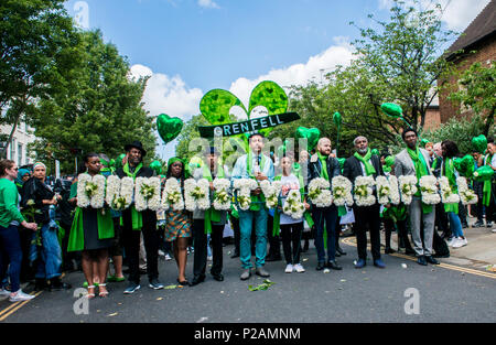 Friends and family members walk towards Grenfell Tower, to mark the one year anniversary of the fire, London, England, UK, 14th June 2018 - Stock Photo