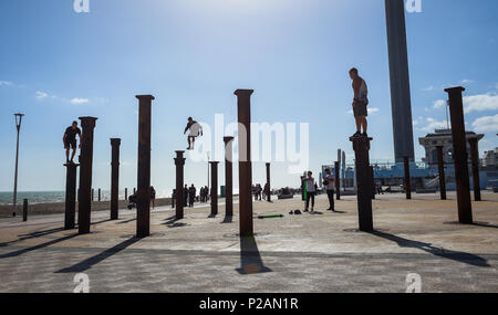 Brighton UK 14th June 2018 - Parkour performers leap across the pillars of the Golden Spiral installation beside the West Pier on Brighton seafront on a glorious sunny evening Photograph by Simon Dack Credit: Simon Dack/Alamy Live News - Stock Photo