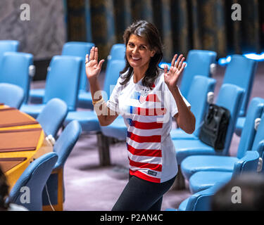New York, USA, 14 June 2018. US Ambassador to the UN Nikki Haley wears a USA soccer jersey as she  enters the Security Council to attend an event marking the opening day of the 2018 FIFA World Cup, being hosted by the Russian Federation from 14 June to 15 July. Credit: Enrique Shore/Alamy Live News - Stock Photo