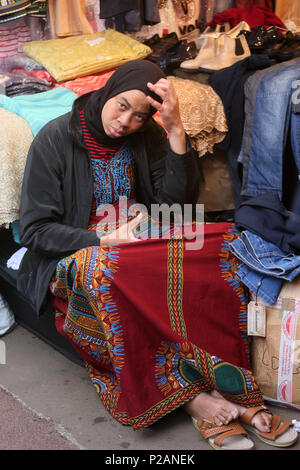 Manchester, UK. 14th June 2018. A women resting on the floor during Chaand Raat, which translated literally means night of the moon.  The festival marks the end of Ramadam and the night before Eid. Longsight Market, Manchester, 14th June, 2018 (C)Barbara Cook/Alamy Live News - Stock Photo