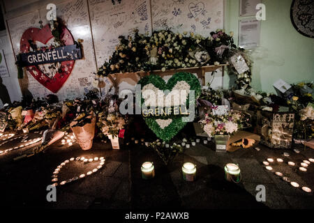London, UK. 14th June, 2018. The flowers memorial at the foot of the Grenfell Tower.On the first anniversary of the Grenfell Tower fire, which killed 72 people, the area around the tower has been filled with flowers, candles and messages to remember those who lost their lives. Credit: Brais G. Rouco/SOPA Images/ZUMA Wire/Alamy Live News - Stock Photo