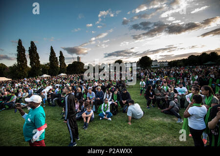 London, UK. 14th June, 2018. People seen gathering at the Kensington Memorial Park at the end of the Silent Walk.On the first anniversary of the Grenfell Tower fire, which killed 72 people, the area around the tower has been filled with flowers, candles and messages to remember those who lost their lives. Credit: Brais G. Rouco/SOPA Images/ZUMA Wire/Alamy Live News - Stock Photo