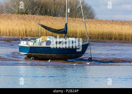 A modern yacht in need of cleaning at its permanent mooring on the River Exe near Topsham, Devon, England, UK - Stock Photo