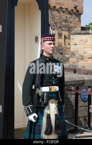 Edinburgh Castle guard in full uniform including scottish tartan kilt, Edinburgh old town, Edinburgh Scotland UK - Stock Photo