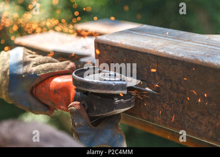 Cutting steel heavy industry by electric flex - Stock Photo
