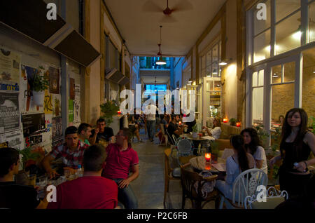Many people in the evening in Cafe Pieto in a Passage in Leika Gaitonia in Lefkosia, Nicosia, Cyprus - Stock Photo