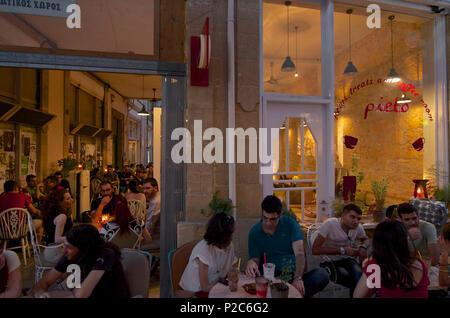 Many people in the evening in Café Pieto in a Passage in Leika Gaitonia in Lefkosia, Nicosia, Cyprus - Stock Photo