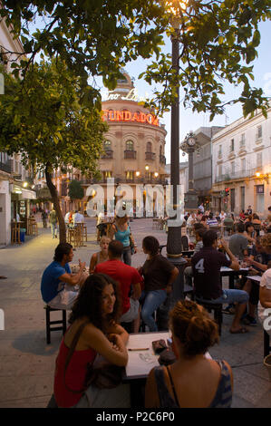 People at tables in the evening in the Calle Larga, Restaurant El Gallo Azur, Jerez de la Frontera, Andalusia, Spain, Europe - Stock Photo