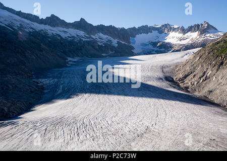 The tongue of the Rhone Glacier, source of the river Rhone, Uri Alps, canton of Valais, Switzerland - Stock Photo