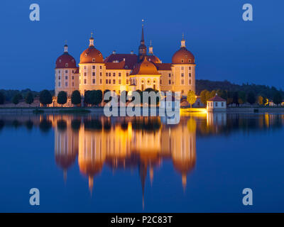 Baroque Moritzburg castle at dusk with its reflection in the castle pond, near Dresden, Saxony, Germany - Stock Photo