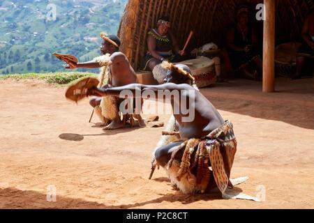 Zulu dancers performing at the PheZulu cultural village in KwaZulu-Natal - Stock Photo
