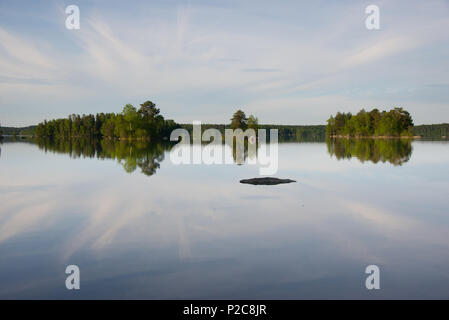 Lake Kukkia water reflections. Lake Kukkia, Luopioinen, Finland. - Stock Photo